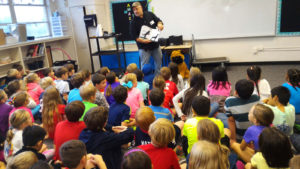 Reading to the children at Bunker Hill Elementary