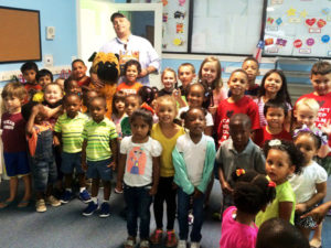 Reading to the children at Shadow Creek Elementary