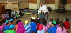 Reading to the children at UOS Montessori School